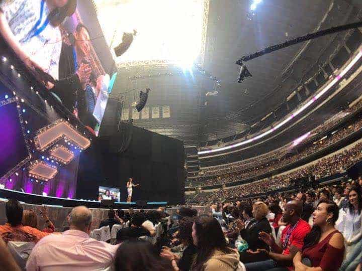 Millie Leung speaking on stage in front of 23000 people at AT&T Stadium, Texas, USA